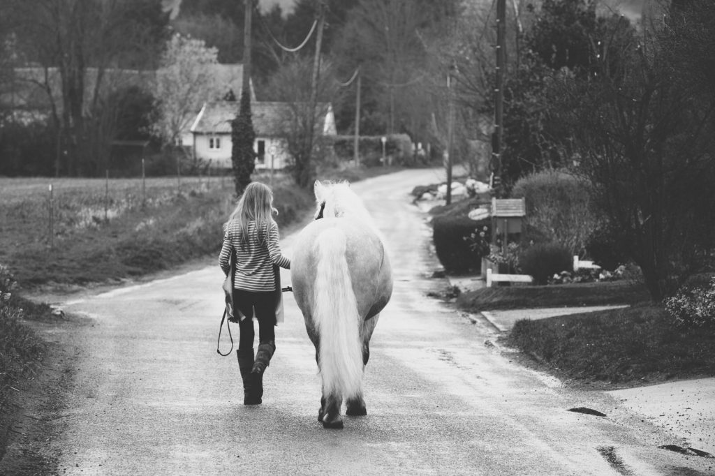 Girl walking with her horse